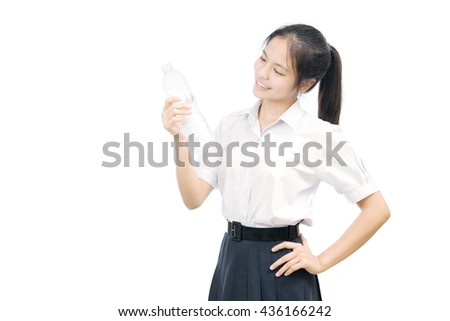 portrait of an Asian student holding the bottle on white background - stock photo