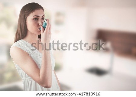 Portrait of an asthmatic woman against empty modern kitchen - stock photo