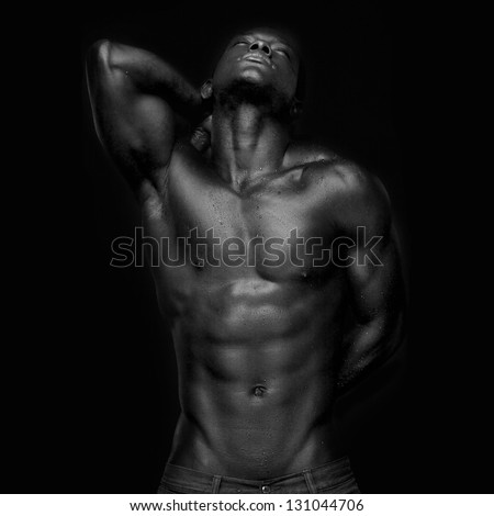 Portrait of an athletic african american looking up - black and white - stock photo