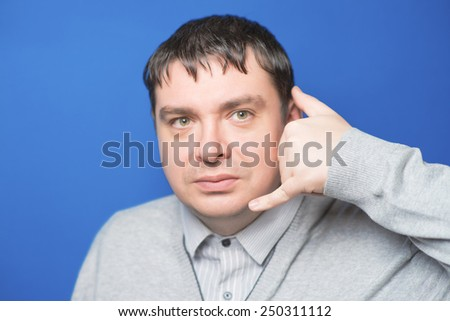 Portrait of an attractive adult man saying at you call me  - stock photo