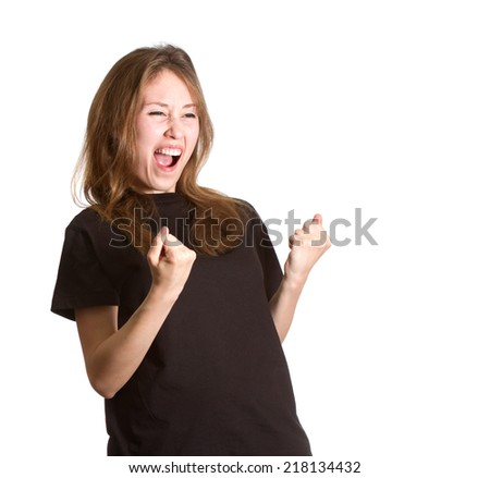 Portrait of an attractive beautiful happy young caucasian girl gesturing success yelling  with open mouth, semi closed eyes and both hands picked up isolated on white background with copy space.