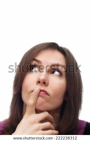 Portrait of an attractive beautiful pretty cute young thoughtful brown haired caucasian woman (lady, girl, female, person, model) who is making holding finger at her lips. Isolated on white background - stock photo