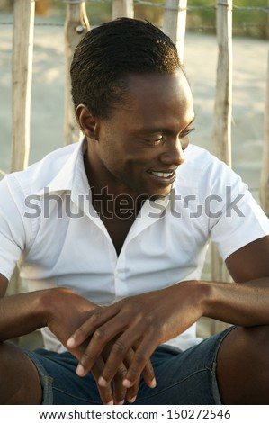 Portrait of an attractive black man smiling outdoors