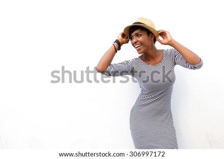 Portrait of an attractive black woman smiling with hat against white background  - stock photo