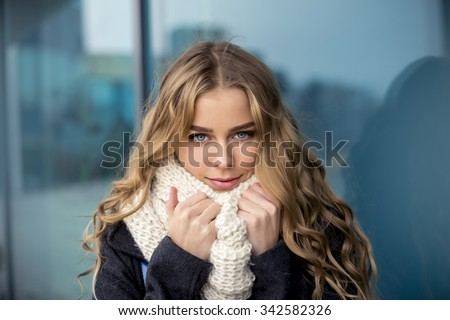 Portrait of an attractive blonde in the street - stock photo
