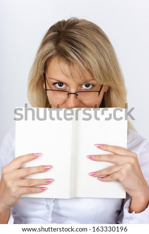 Portrait of an attractive blonde with a book - stock photo