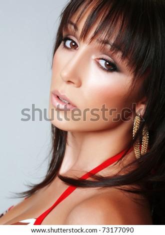 Portrait of an attractive brunette girl in her bra - stock photo