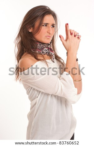 Portrait of an attractive brunette with an imaginary gun - stock photo