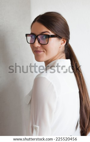 Portrait of an attractive brunette with glasses - stock photo