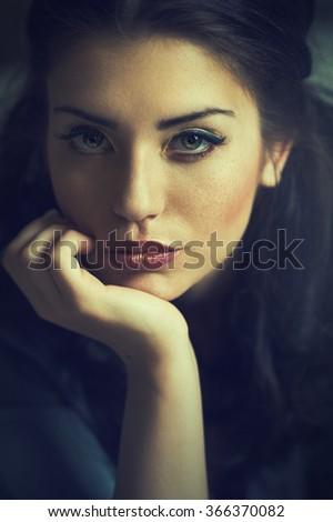 Portrait of an attractive brunette woman - stock photo