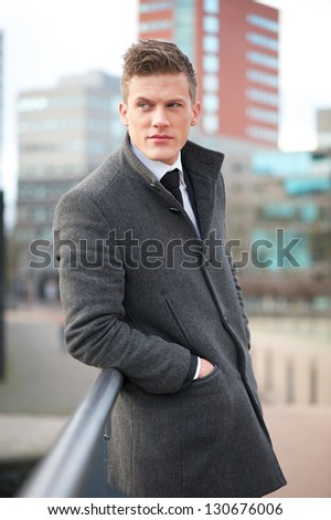 Portrait of an attractive businessman standing outdoors - stock photo