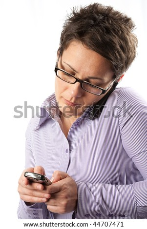 Portrait of an attractive businesswoman using mobile phones