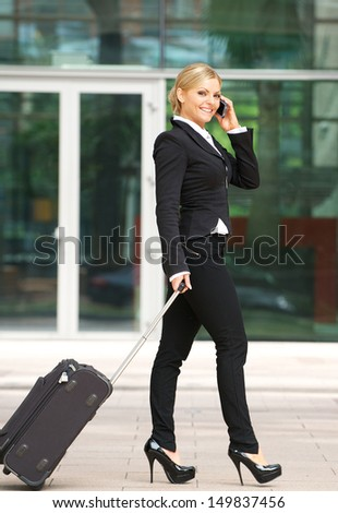 Portrait of an attractive caucasian business woman talking on mobile phone - stock photo