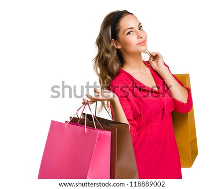 Portrait of an attractive cool young brunette with shopping bags.