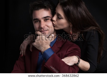 Portrait of an attractive couple - stock photo