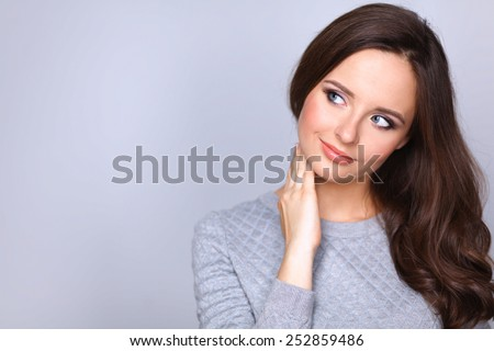 Portrait of an attractive fashionable young brunette woman - stock photo