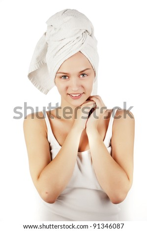 Portrait of an attractive girl in a white T-shirt with a towel on his head, a portrait of girl isolated on white - stock photo