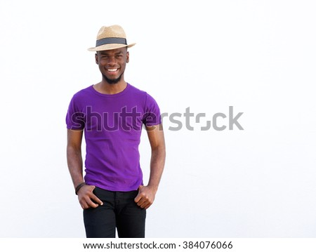 Portrait of an attractive male fashion model posing against white background  - stock photo