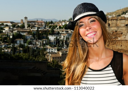 Portrait of an attractive smiling blonde woman with sun hat