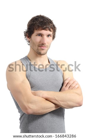 Portrait of an attractive sportsman posing with folded arms isolated on a white background        - stock photo