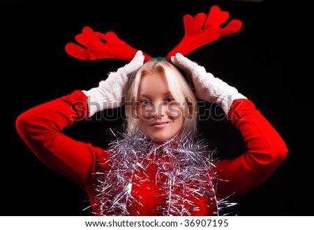 Portrait of an attractive young blonde with horns on her head. Christmas time - stock photo