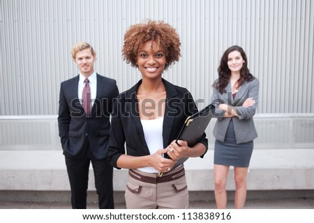 Portrait of an attractive young business group standing together at office - stock photo