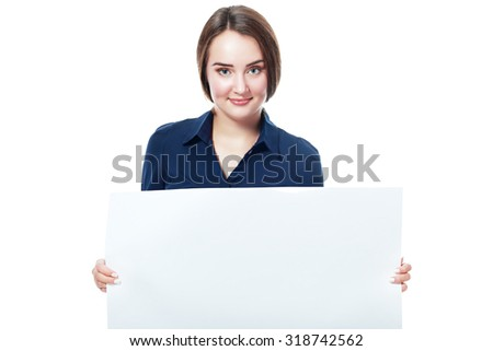 Portrait of an attractive young business woman in glasses holding blank card - over white background