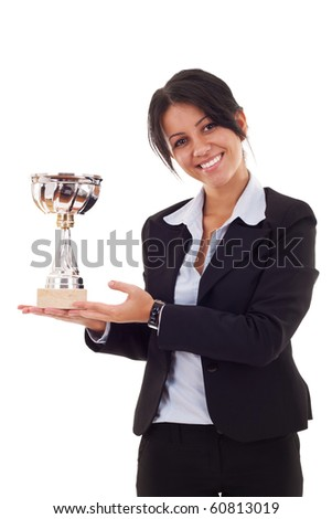 Portrait of an attractive young business woman winning a trophy against white background - stock photo
