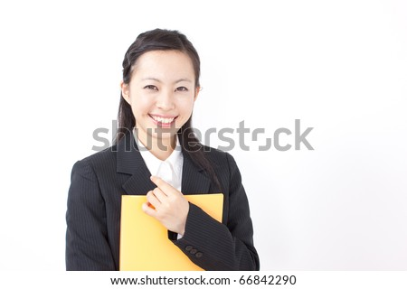 Portrait of an attractive young businesswoman holding yellow file