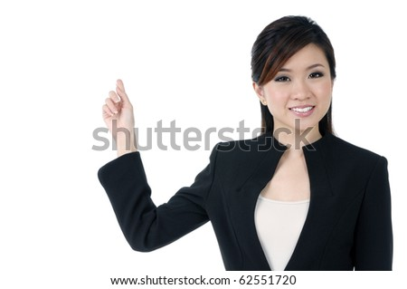 Portrait of an attractive young businesswoman pointing at copy space,  over white background. - stock photo