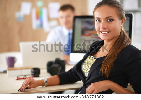 Portrait of an attractive young businesswoman sitting at her dek in the office.
