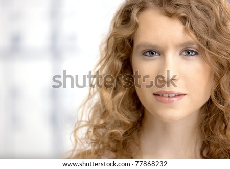 Portrait of an attractive young female, blond, long hair, blue eyes.? - stock photo
