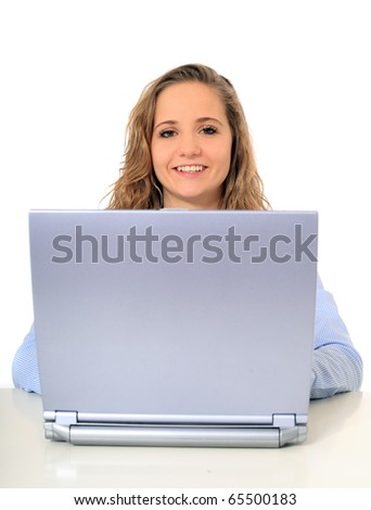 Portrait of an attractive young girl using notebook computer. All on white background. - stock photo