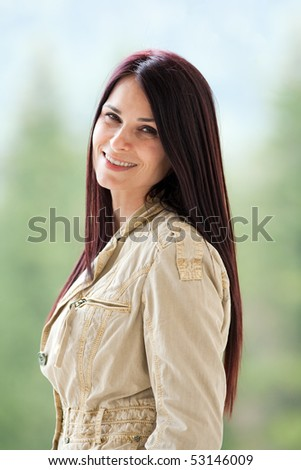 Portrait of an attractive young lady isolated on blurred background - stock photo