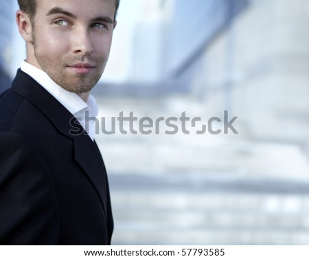 Portrait of an attractive young man outside