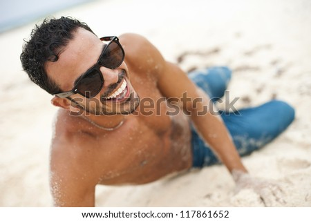 Portrait of an attractive young model on a tropical beach - stock photo