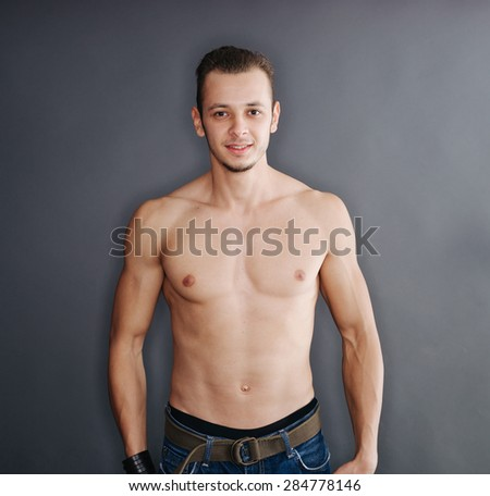 Portrait of an attractive young muscular man  - stock photo