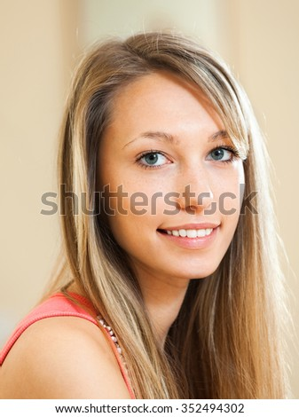 Portrait of an attractive young woman at home