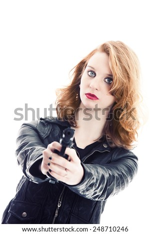 Portrait of an attractive young woman holding a gun.  Isolated on white. - stock photo