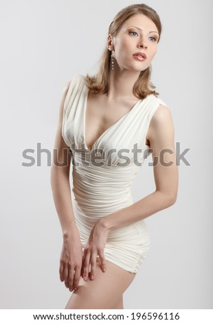 portrait of an attractive young woman in sexy dress - stock photo