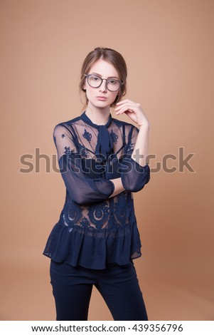 Portrait of an attractive young woman in spectacles for vision, stylish woman, studio picture. Beautiful woman in stylish new glasses, joy - stock photo