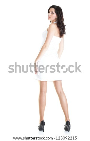 Portrait of an attractive young woman standing isolated white background