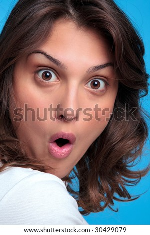 Portrait of an attractive young woman with a shocked expression of her face