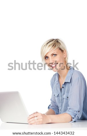 Portrait of an attractive young woman with laptop against white background