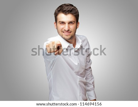 Portrait Of An Businessman Pointing Finger Isolated On Grey Background - stock photo