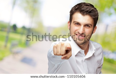 Portrait Of An Businessman Pointing Finger, Outdoor - stock photo