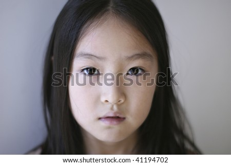 portrait of an eight-year old asian girl.