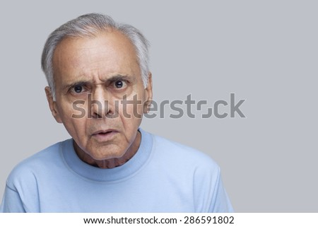 Portrait of an elderly angry man