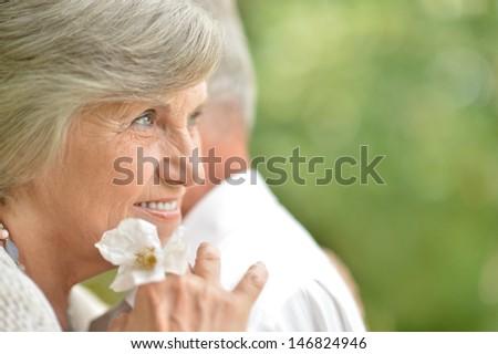 Portrait of an elderly couple in love on the walk - stock photo