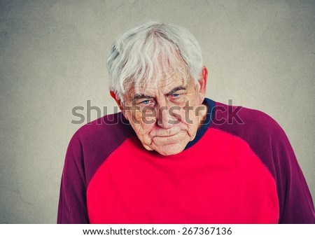 Portrait of an elderly depressed man looking down  - stock photo